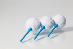White golf balls and blue tees Royalty Free Stock Photography