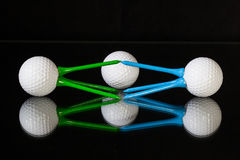 White golf balls and different colored tees Stock Photography
