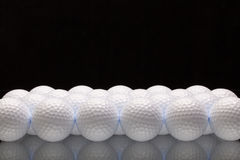 White golf balls on a glass desk Stock Image