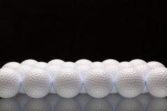 White golf balls on a glass desk Stock Image