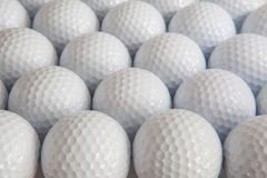 White golf balls. In the open box Royalty Free Stock Photography