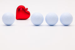 White golf balls and red heart Stock Photography