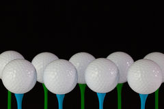 White golf balls on a wooden tees Stock Images