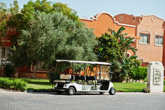 White golf car with back seat on resort. Royalty Free Stock Images
