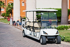 White golf car with back seat on resort. Royalty Free Stock Image