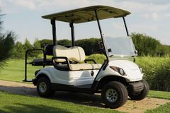 Stylish white golf cart Stock Photos
