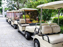 White golf cart. Is park near the entrance of palace Stock Images