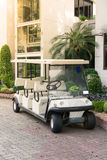 White golf cart with back seats in the public park royalty free stock photos
