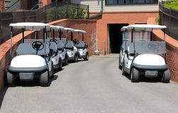White Golf Carts ready for Tee-off Royalty Free Stock Image