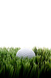 A white golfball on green grass Royalty Free Stock Images