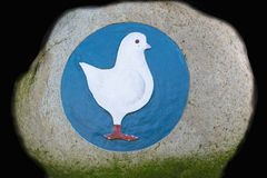 White goose on a blue background. On a stone shot in Garrel in Germany Lower Saxony stock photography