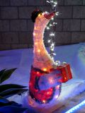 White Goose with Xmas Lights. White Goose in front garden with xmas lights stock photo