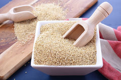 White grain quinoa on blue wood background. Stock Photo