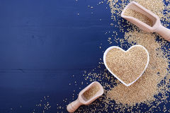 White Grain Quinoa On Blue Wood Background. Royalty Free Stock Image