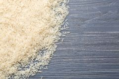 White grain rice. On wooden background Royalty Free Stock Images