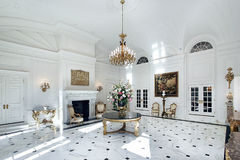 White grand foyer. With fireplace and chairs Royalty Free Stock Photography