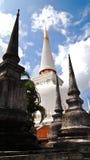 Pagoda. White grand pagoda among black pagoda Royalty Free Stock Photography