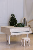 White grand piano in a beautiful interior Royalty Free Stock Photos