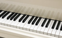 White grand piano keyboard Stock Photo