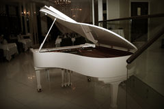 White grand piano Royalty Free Stock Image