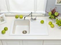 White granite kitchen sink with mixer tap Stock Photo
