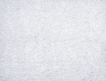 White granular textured background. Blank roughcast background - White granular wall texture Royalty Free Stock Image