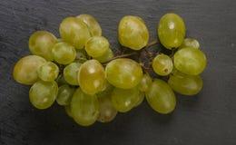 White grape on black background Royalty Free Stock Photos