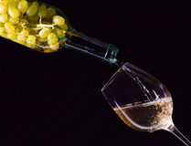 White grape in bottle and glass of wine Royalty Free Stock Photo