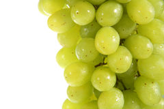 White Grapes. White seedless grapes with visible water droplets on a white background Stock Photo