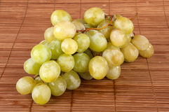 White grapes. Nice white grapes on bamboo Stock Photos