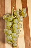 White grapes. Bunch of white grapes over wood background Royalty Free Stock Photography