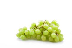 White grapes. A bunch of white grapes on white Royalty Free Stock Photography
