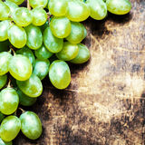 White grapes bunch over wooden background. Green grape, country Stock Photography