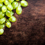White grapes bunch over wooden background. Green grape, country Stock Photos