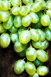 White grapes bunch over wooden background. Green grape, country Royalty Free Stock Image