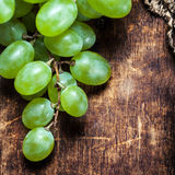 White grapes bunch over wooden background. Green grape, country Royalty Free Stock Images