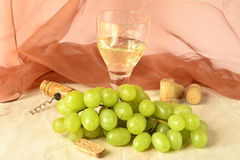 White grapes with glass of wine Stock Photos