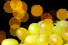White Grapes on Glowing Background Stock Photos