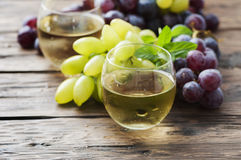 White grapes juice on the wooden table Royalty Free Stock Photos