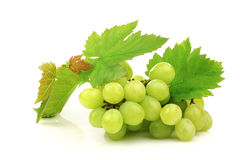 White grapes and some foliage Stock Photo