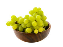 White grapes in wooden bowls. Isolated in white background Stock Photography