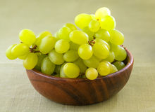 White grapes in wooden bowls. On tablecloth Stock Images