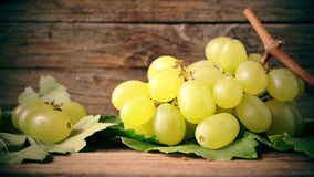 White grapes on wooden table stock video