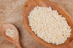White grated corn kernels in wooden bowl Royalty Free Stock Images