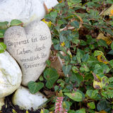 White grave ornament with heart and german words Royalty Free Stock Photography
