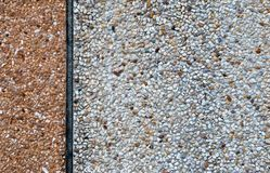 White gravel and concrete wall Stock Photography