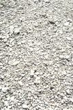 White gravel details. White gravel texture is detailed in a closeup image Stock Photo