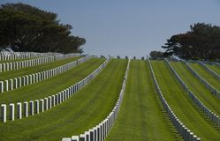 White graves in Rosecrans National Cemetery, San Diego, California, USA. FORT ROSECRANS NATIONAL CEMETRY, SAN DIEGO - APRIL 17, 2016: White graves in Rosecrans Stock Photos