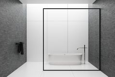 White and gray bathroom, round tub. White tiles and gray wall bathroom interior with a tiled white floor, a black towel in the corner and a white tub behind a royalty free illustration