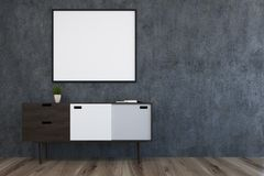 White, gray and black chest of drawers. Close up of a white, black and gray chest of drawers and a vertical poster hanging in a concrete wall living room with a Stock Images